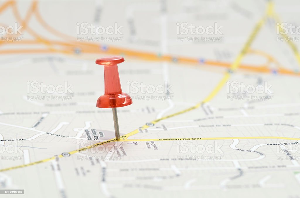 Close-up of red pushpin on a map stock photo