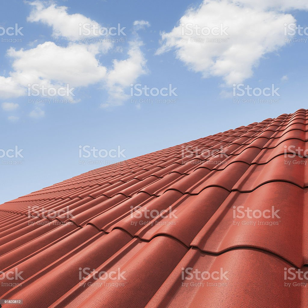 Closeup of red roof and clear blue sky royalty-free stock photo