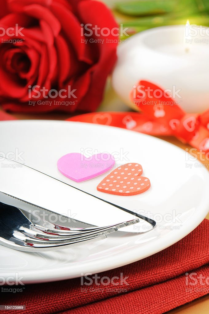 Closeup of red rose and cutlery royalty-free stock photo
