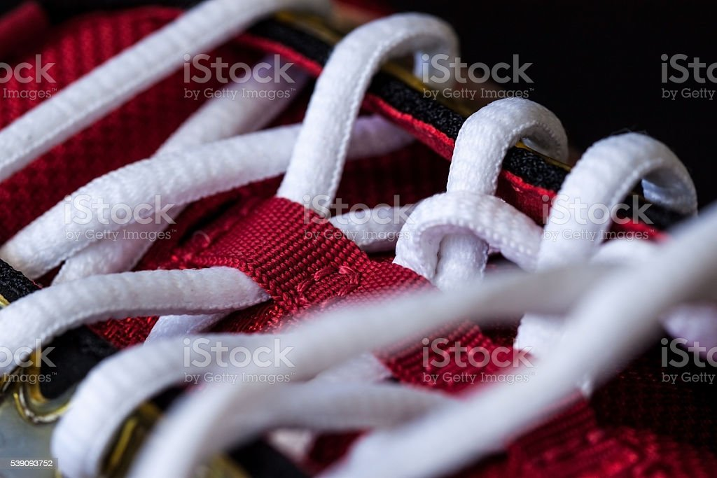 Close-up of red sneaker with white laces stock photo
