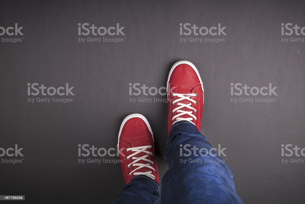 Close-up of red sneakers on gray background stock photo