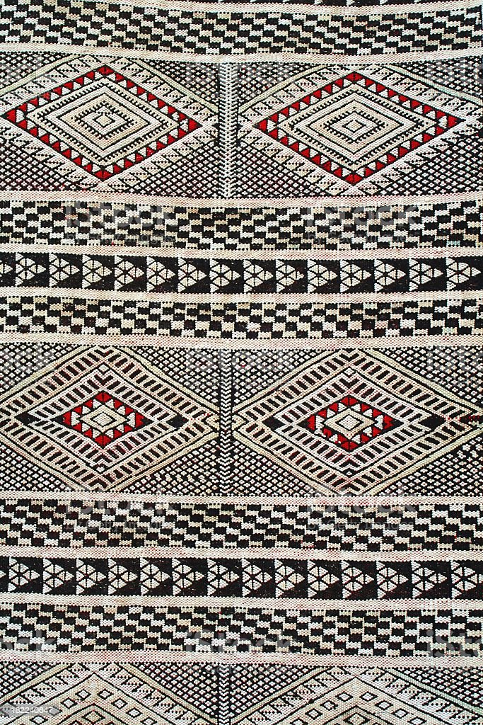 Close-up of red, white and black Berber carpet pattern stock photo