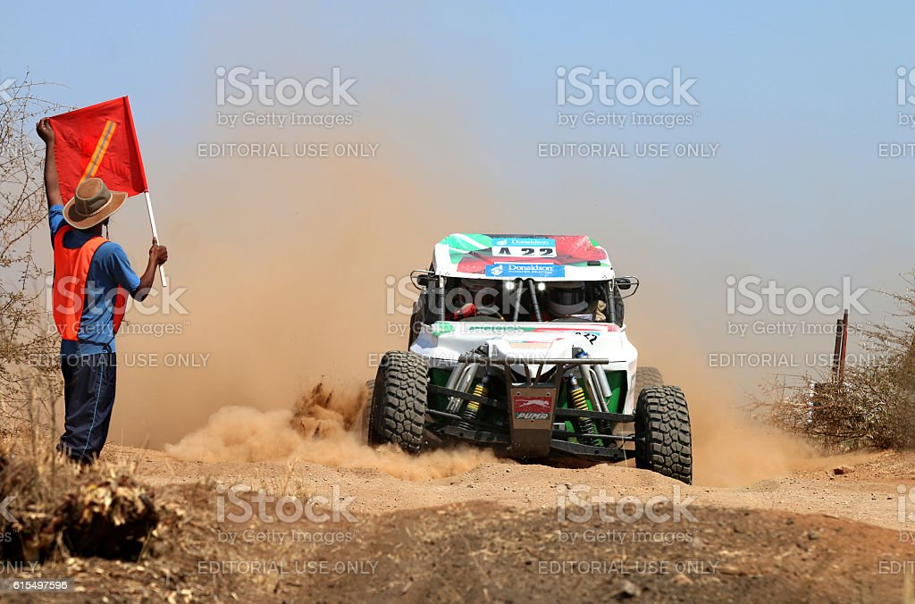 Close-up of red white Bat rally car stopped at crossing stock photo