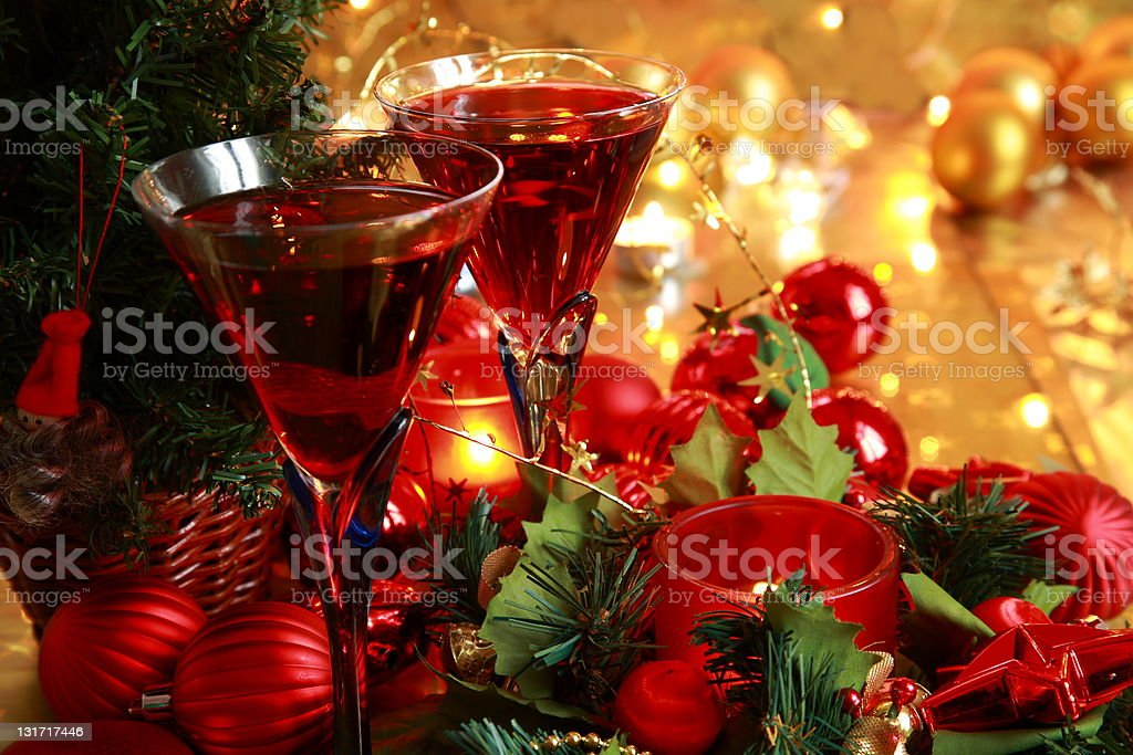 Closeup of red wine,baubles and candle lights. royalty-free stock photo