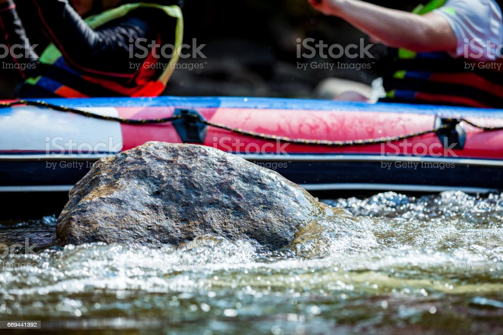 Close-up of reef with group young person are rafting on the river, at tourist attraction stock photo
