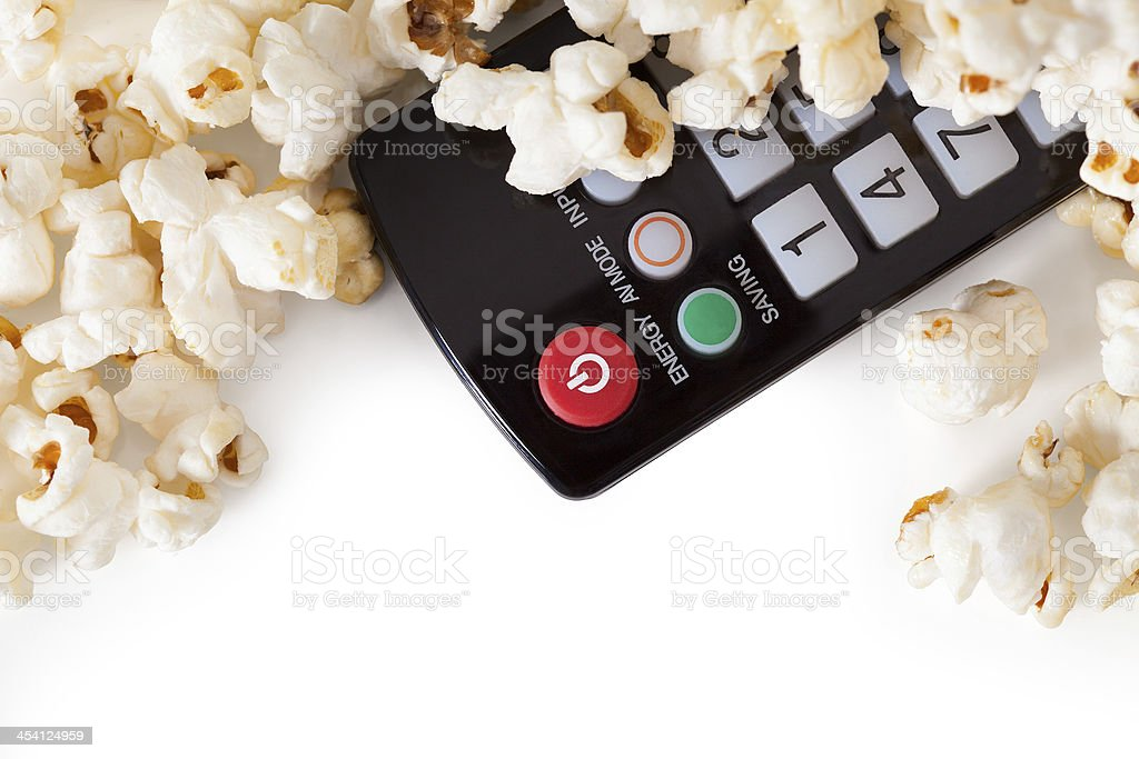 Close-up Of Remote Control And Popcorn royalty-free stock photo