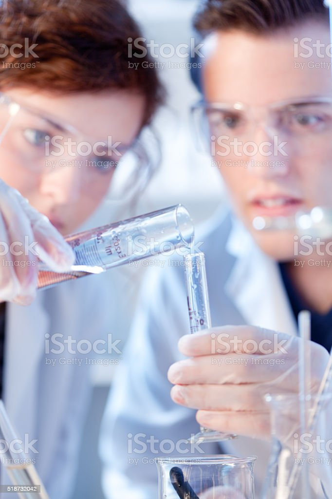 Close-up of Research Scienctists Chemists Working in Laboratory Horizontal stock photo