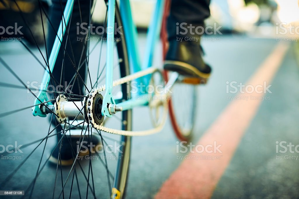 Close-up of retro bicycle ridden by man stock photo