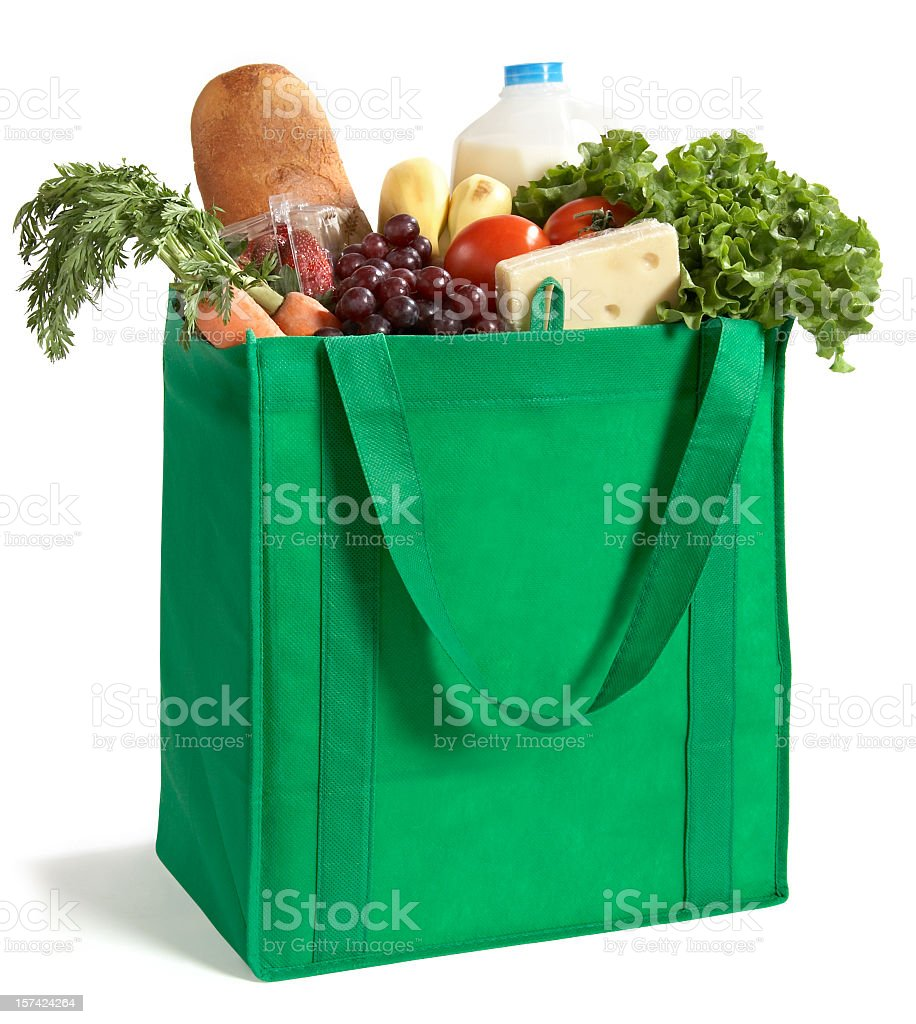 Close-up of reusable grocery bag filled with fresh produce stock photo