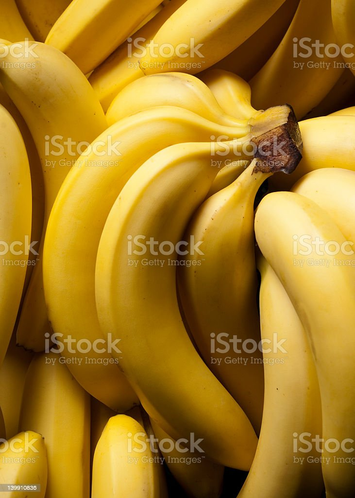 Close-up of ripe, yellow banana bunches stock photo