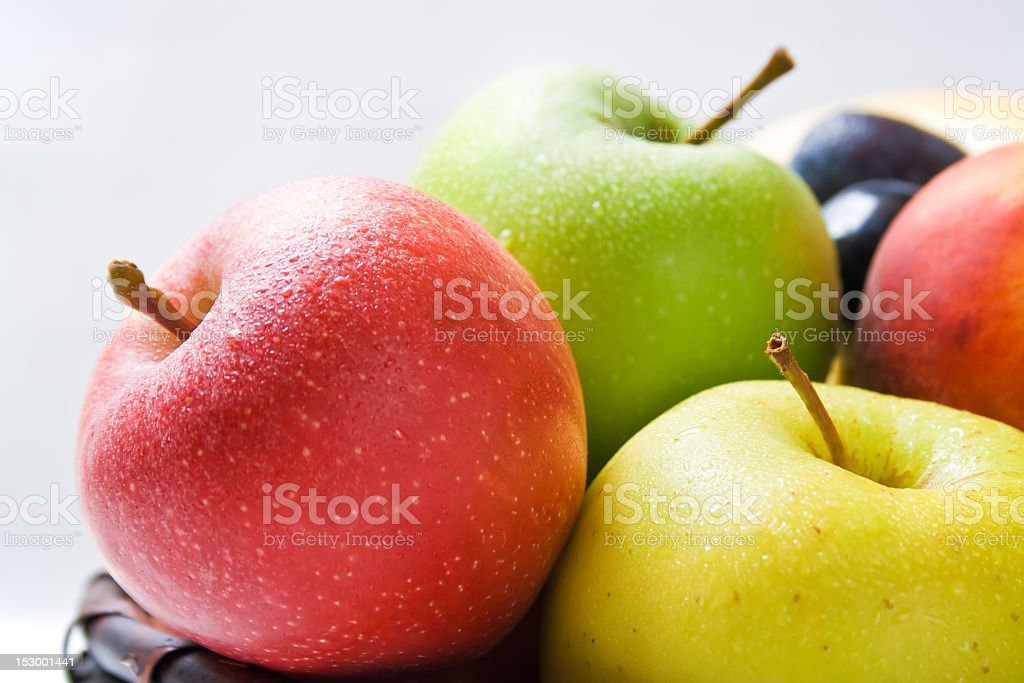 Close-up of ripe yellow, green, and red apples royalty-free stock photo