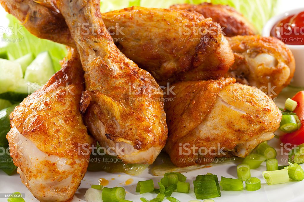 Close-up of roasted chicken drumsticks royalty-free stock photo