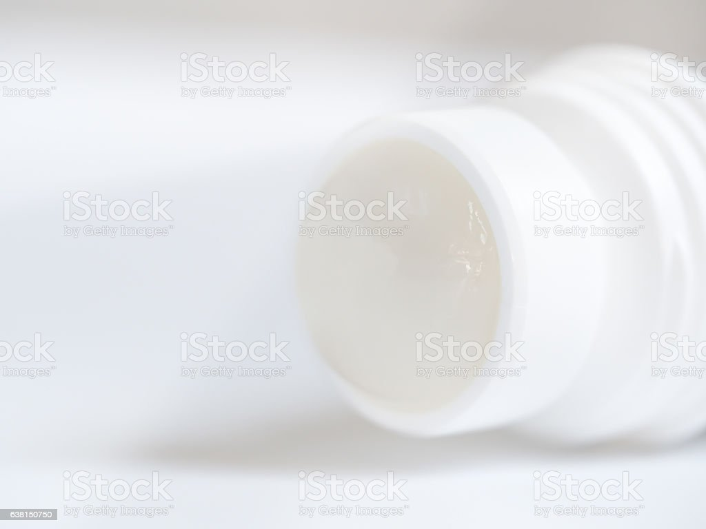 Closeup of Roll-on deodorant  isolated on gray background stock photo