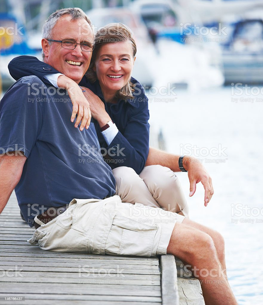 Close-up of romantic senior couple sitting together by sea royalty-free stock photo
