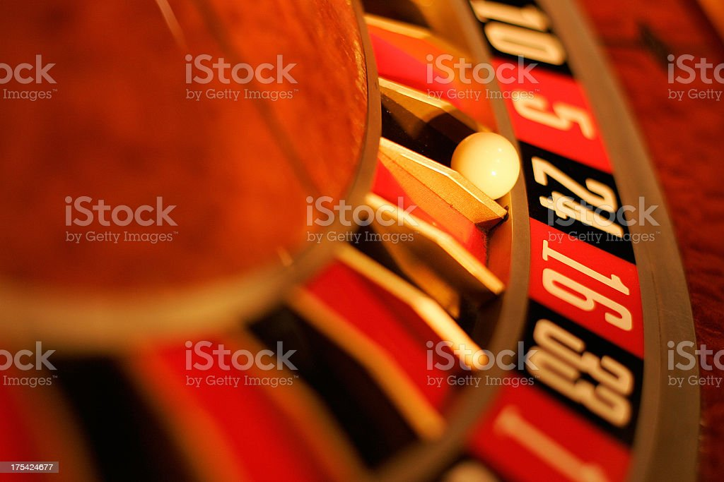 Close-up of roulette wheel showing a few numbers stock photo