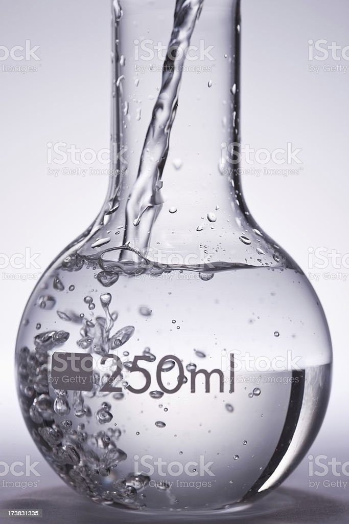 Closeup of round bottom flask filled with liquid stock photo
