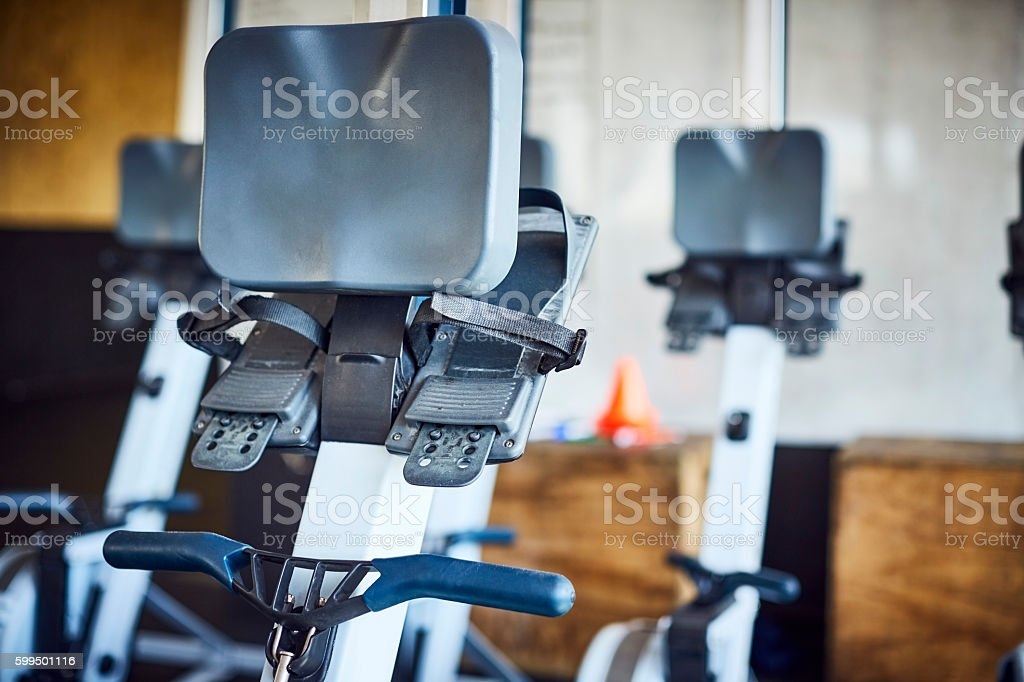 Close-up of rowing machine in gym stock photo