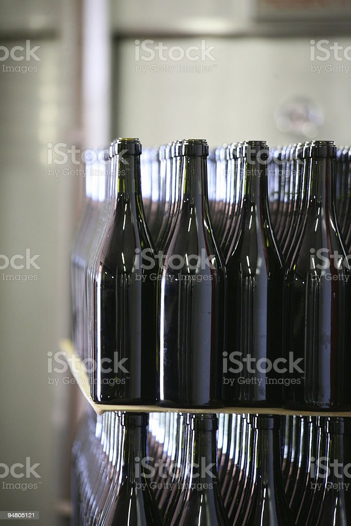 Close-up of rows full of generic wine bottles royalty-free stock photo