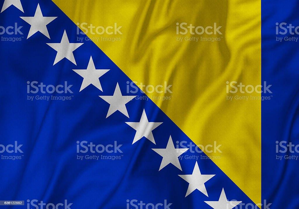 Closeup of Ruffled Bosnia and Herzegovina Flag, Bosnia and Herzegovina Flag Blowing in Wind stock photo