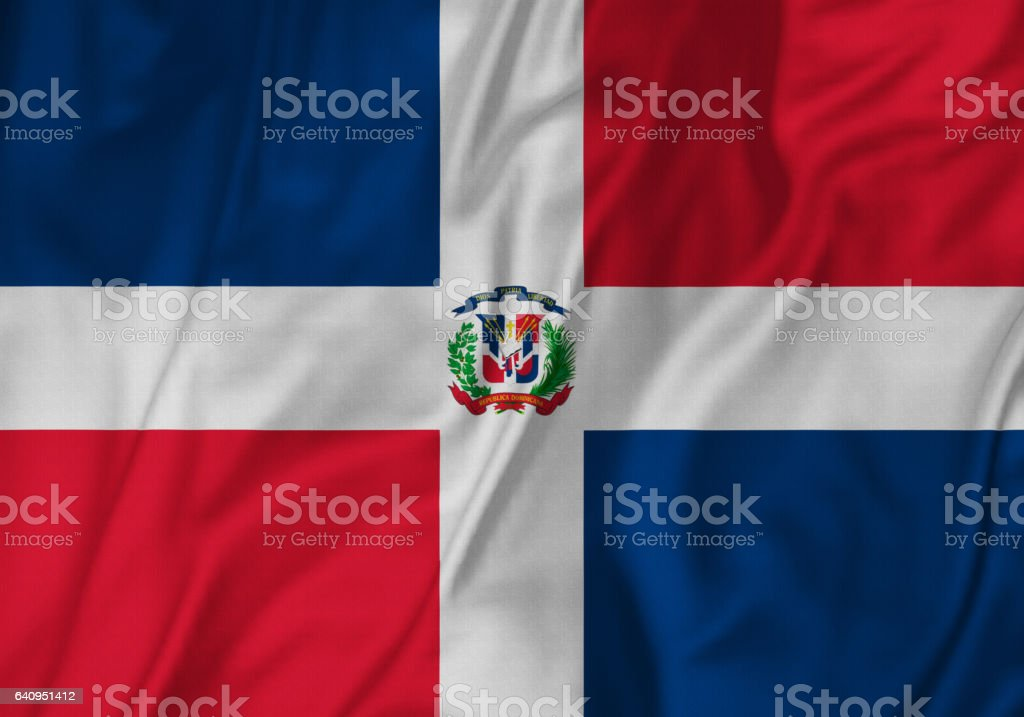 Closeup of Ruffled Dominican Republic Flag, Dominican Republic Flag Blowing in Wind stock photo