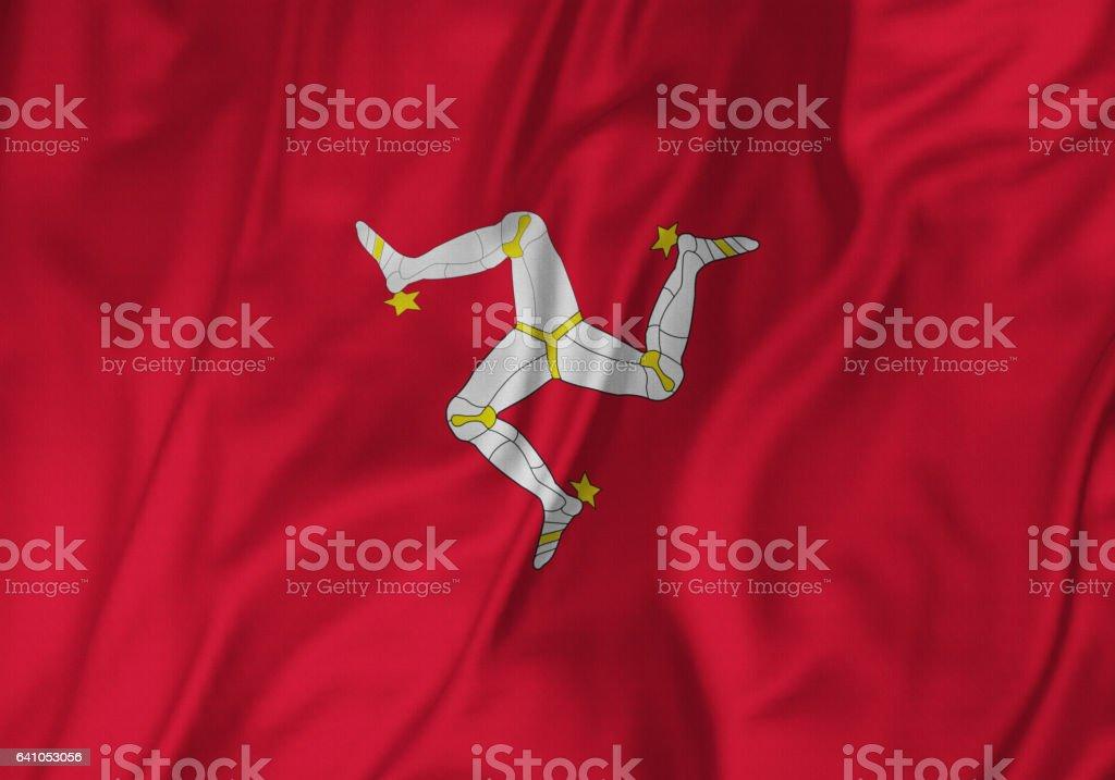 Closeup of Ruffled Isle of Mann Flag, Isle of Mann Flag Blowing in Wind stock photo