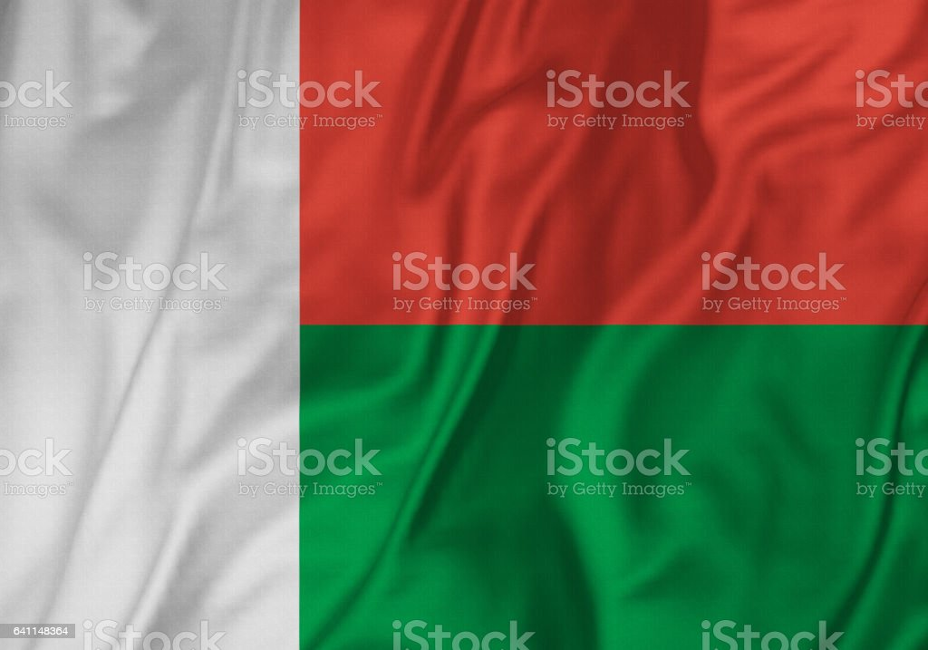 Closeup of Ruffled Madagascar Flag, Madagascar Flag Blowing in Wind stock photo
