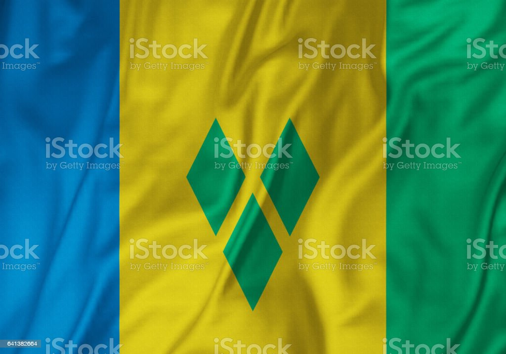 Closeup of Ruffled Saint Vincent and the Grenadines Flag, Saint Vincent and the Grenadines Flag Blowing in Wind stock photo