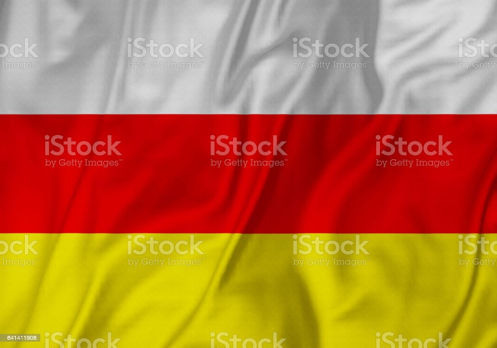 Closeup of Ruffled South Ossetia Flag, South Ossetia Flag Blowing in Wind stock photo