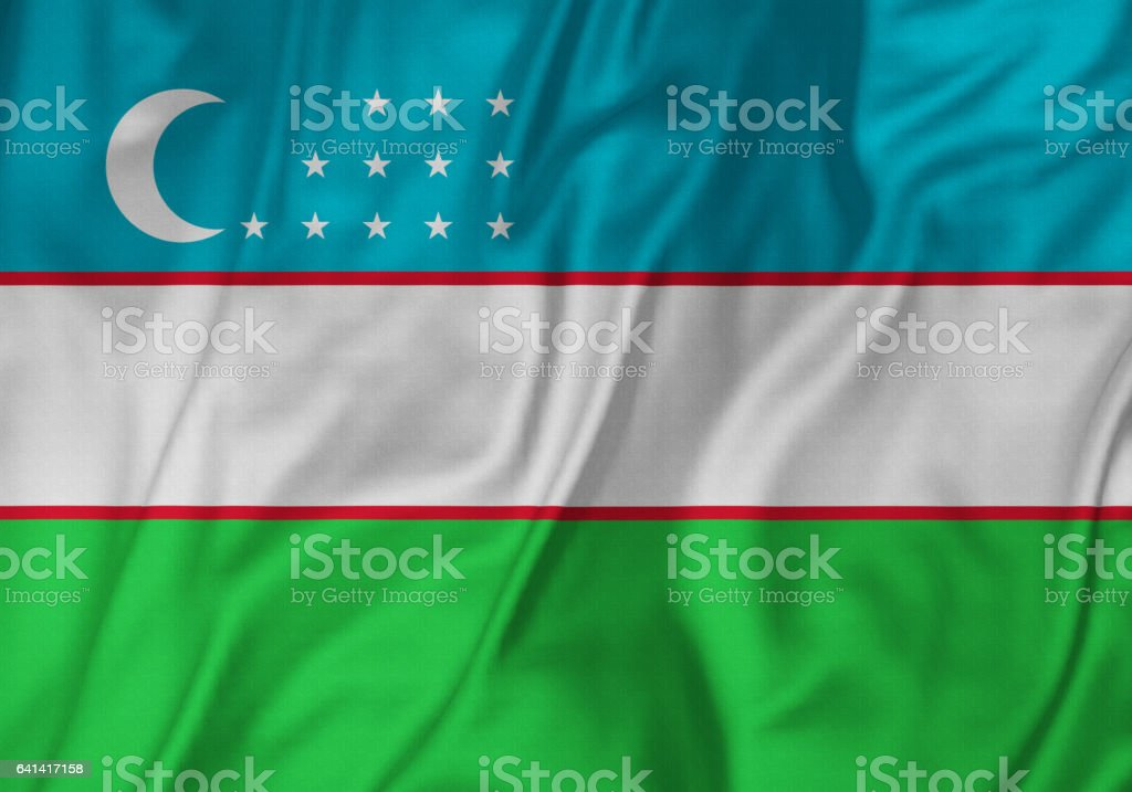 Closeup of Ruffled Uzbekistan Flag, Uzbekistan Flag Blowing in Wind stock photo