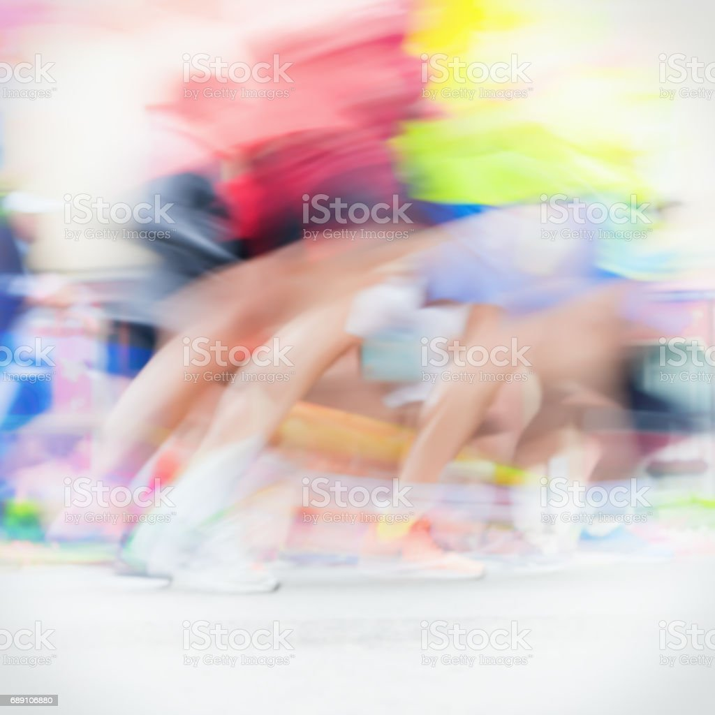 Close-up of runners colorful running feet and legs of runners during marathon on city streets. Abstract blurred sport background, place for your text stock photo