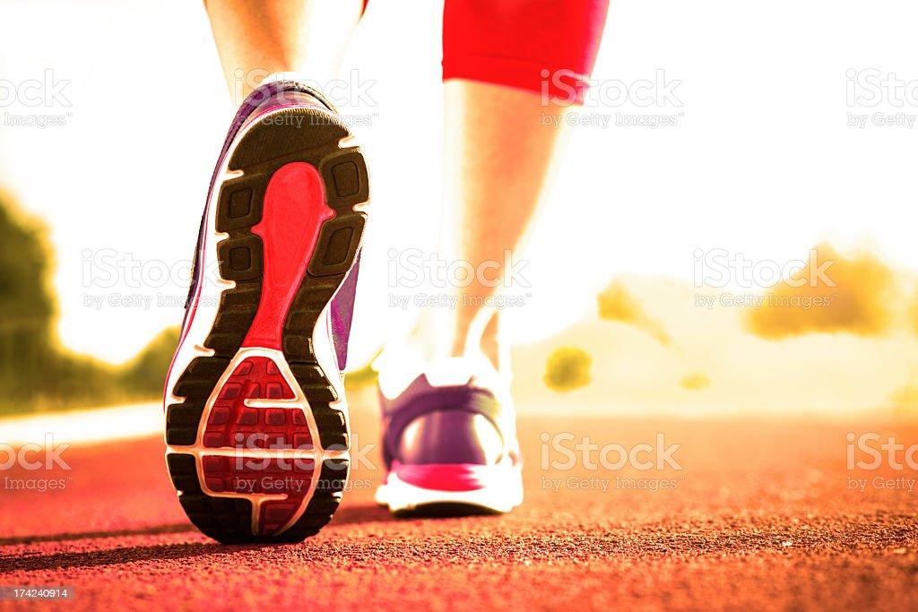 A close-up of runners shoes on a person walking royalty-free stock photo