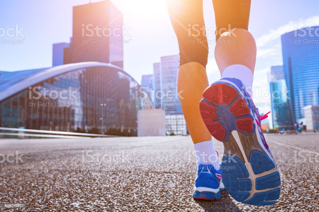 Close-up of running shoes, woman running in a city stock photo