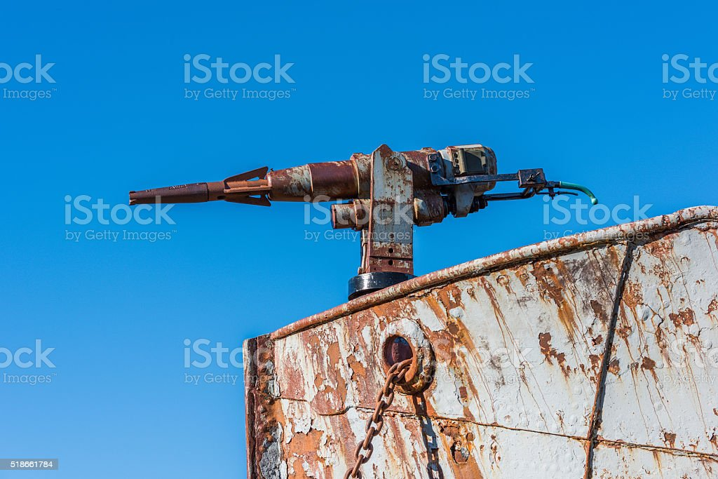 Close-up of rusty harpoon gun in bows stock photo