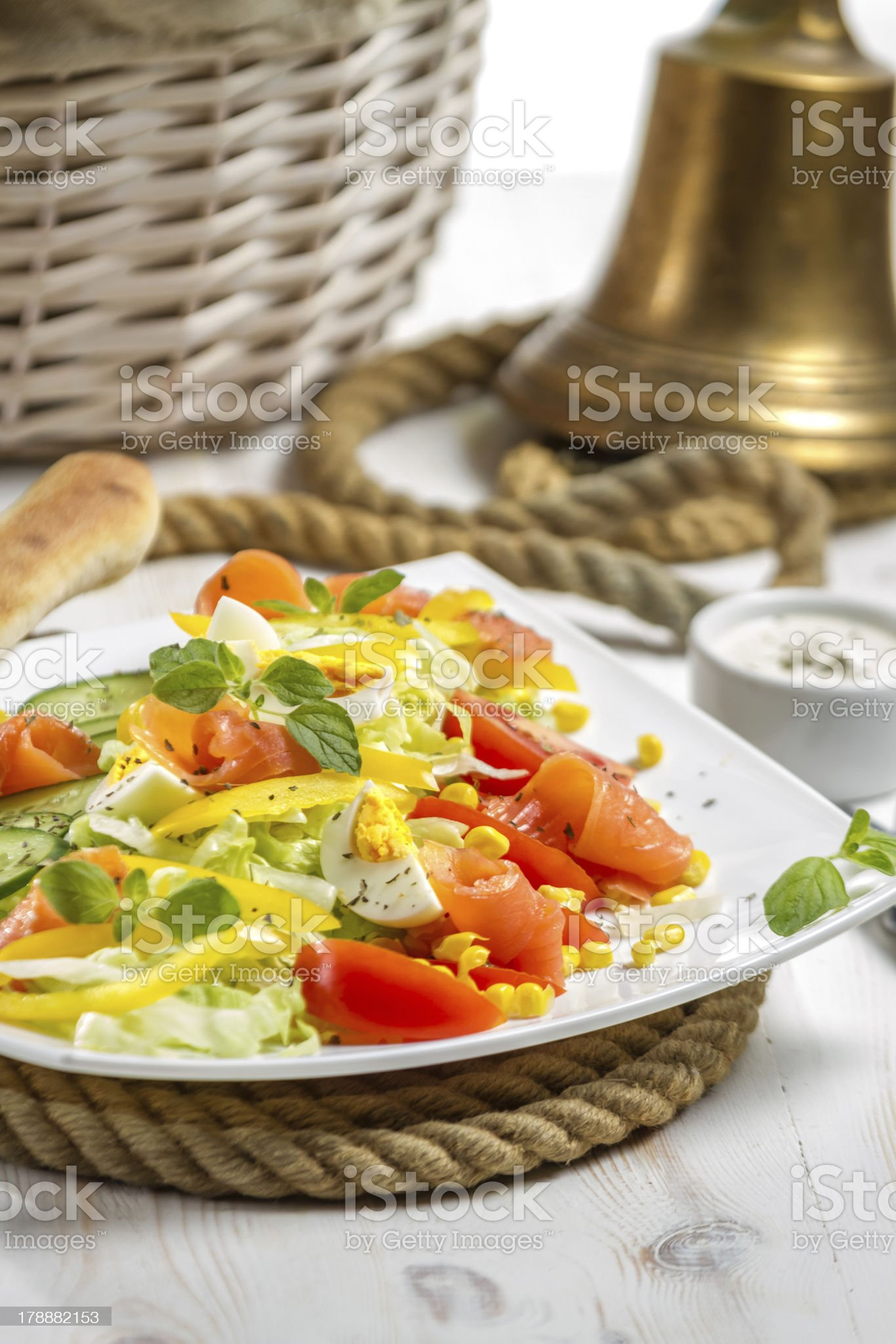 Closeup of salad with salmon and vegetables royalty-free stock photo