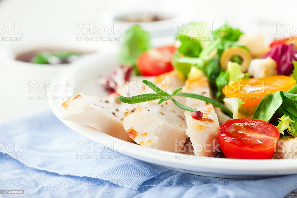 Close-up of salad with sliced chicken breast and vegetables stock photo