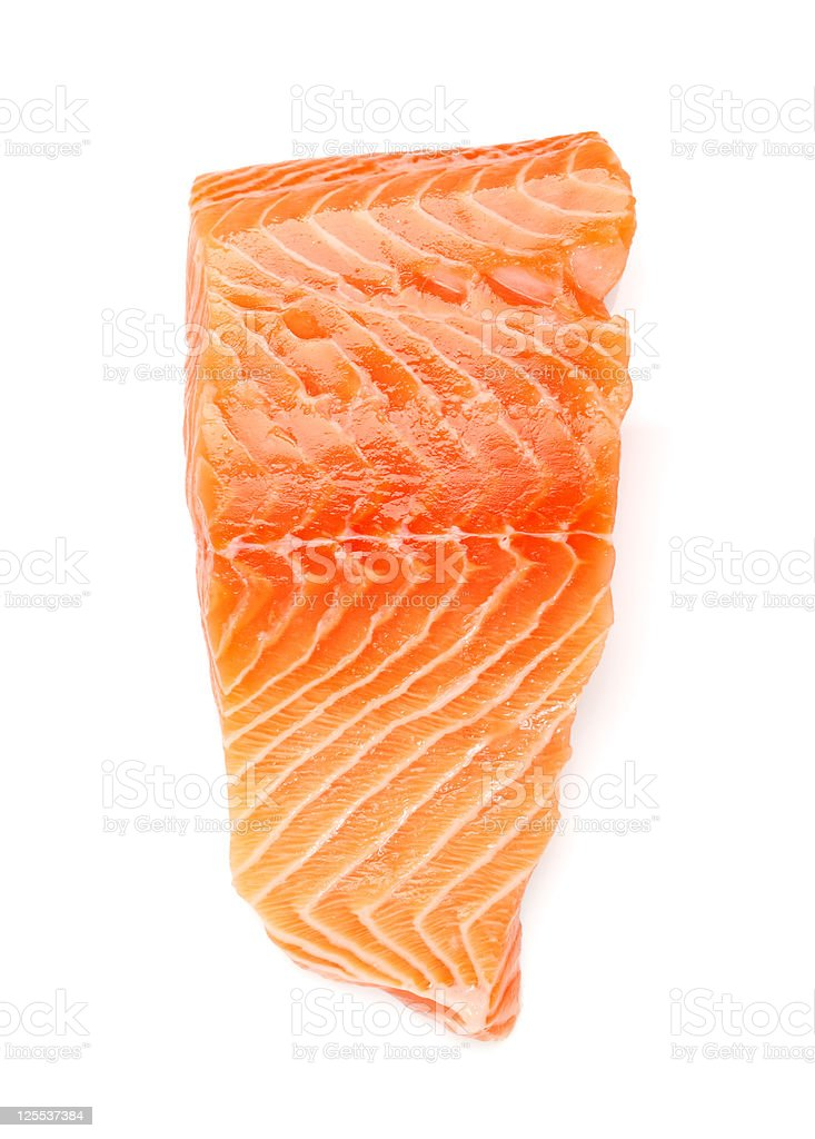 Closeup of salmon fillet against white background stock photo