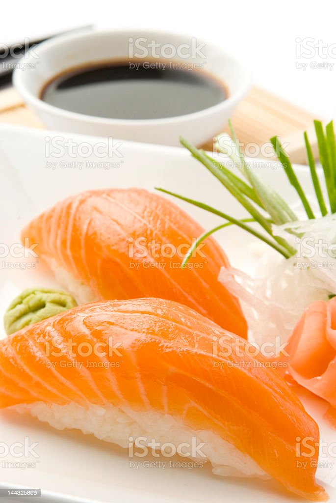Close-up of salmon sushi over rice with soy sauce royalty-free stock photo