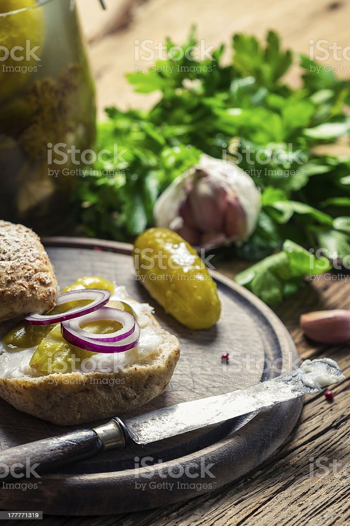 Closeup of sandwich with gherkin, lard and onion royalty-free stock photo