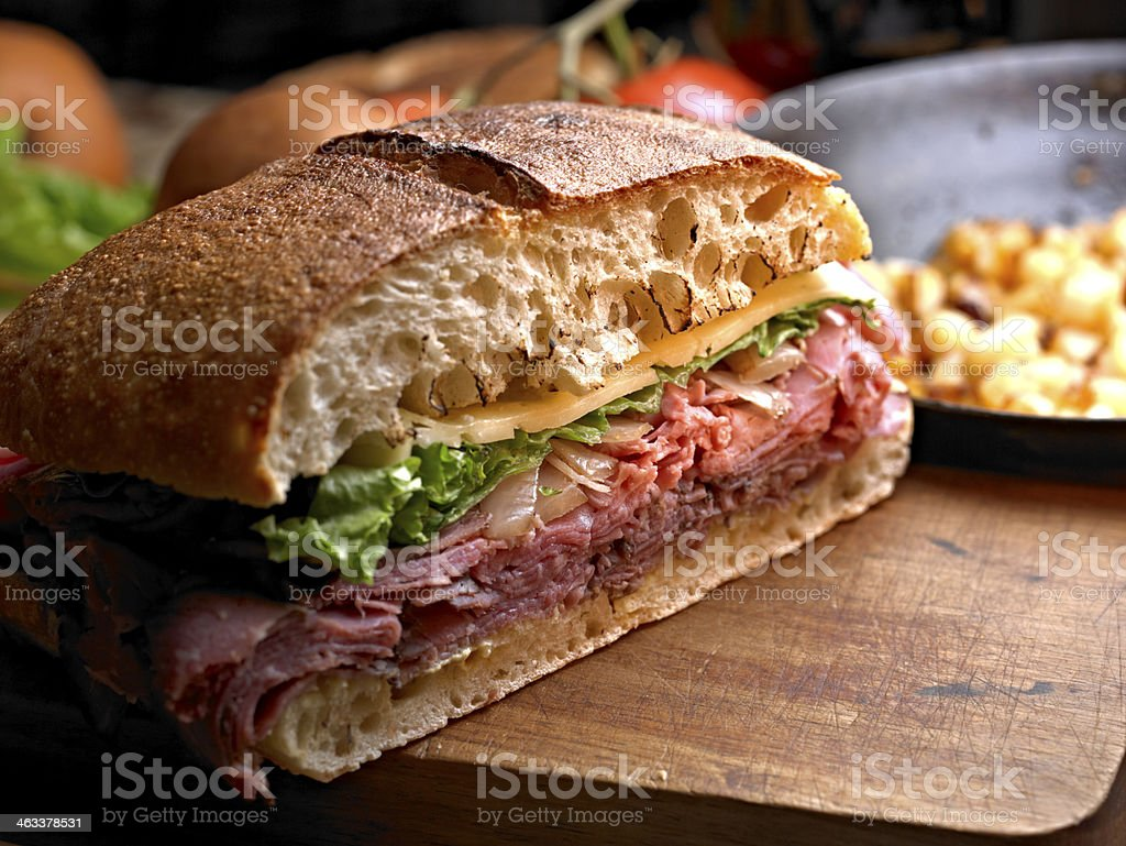 Close-up of sandwich with ham, cheese and more stock photo