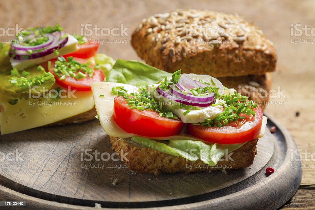 Closeup of sandwich with tomato, onion and lettuce royalty-free stock photo