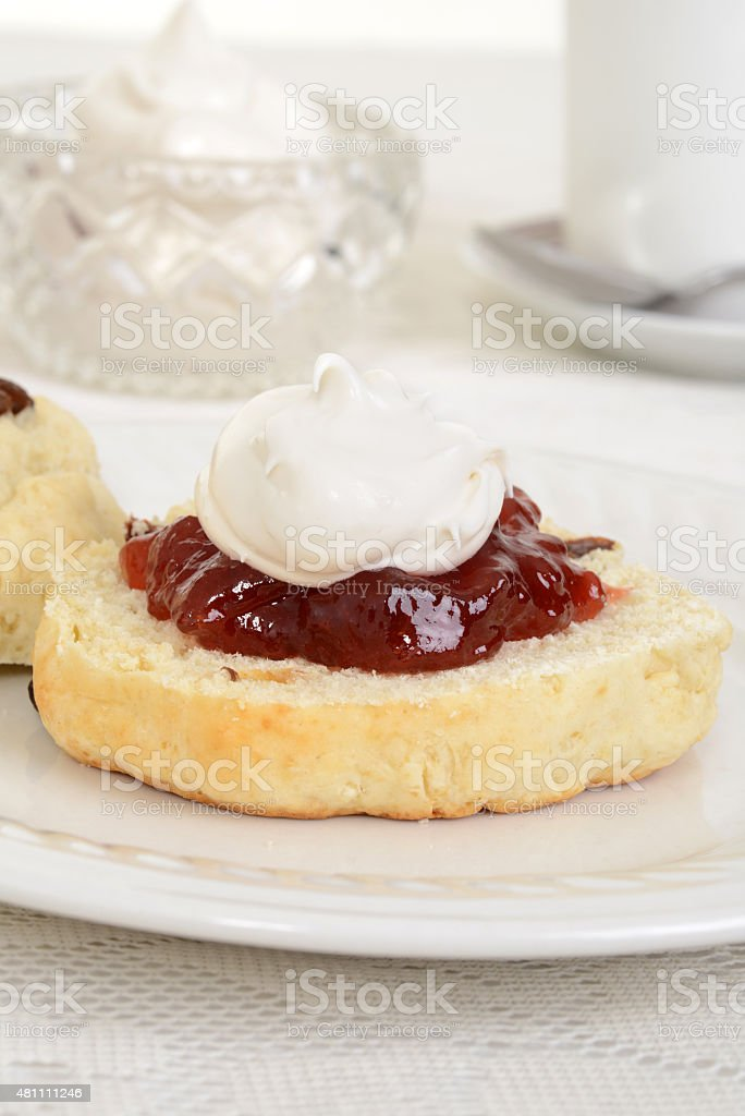closeup of scone with cream and jam stock photo