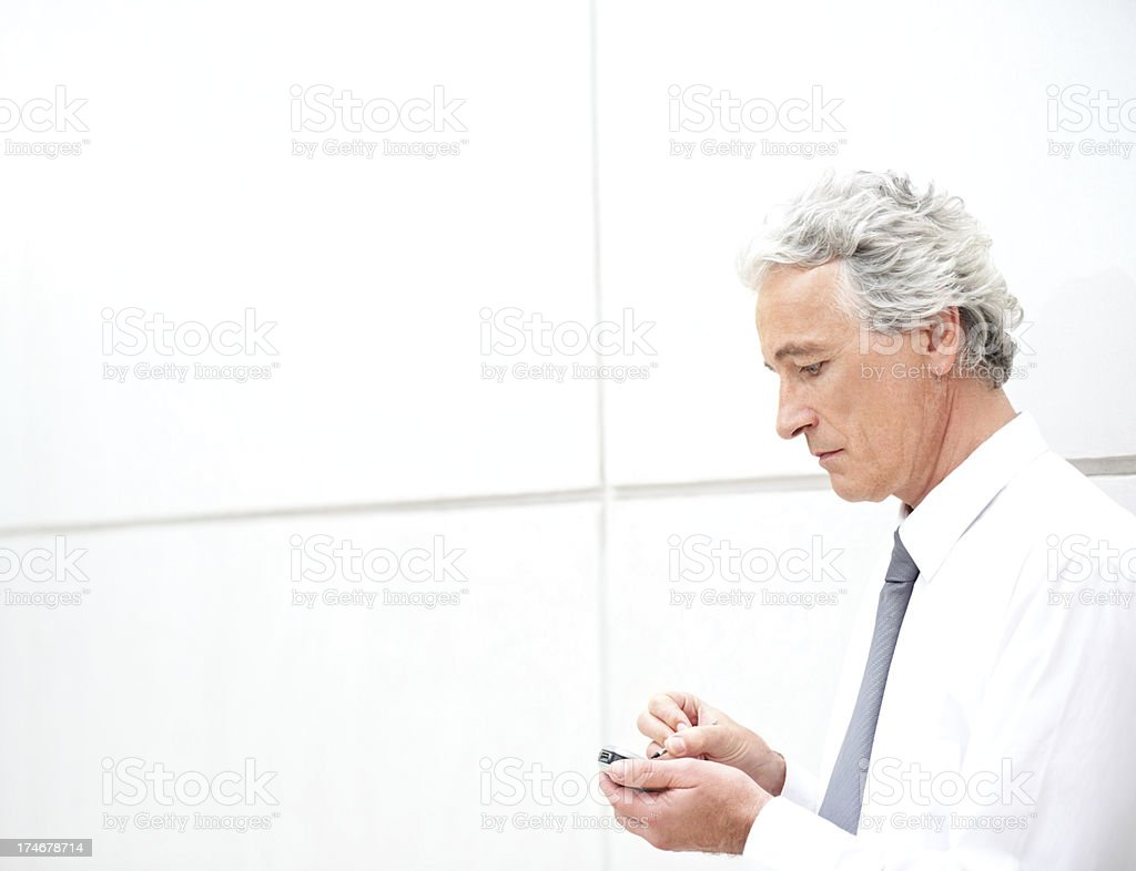 Close-up of senior businessman browsing on cellphone royalty-free stock photo