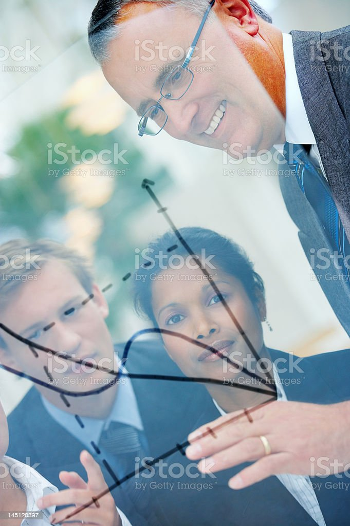 Close-up of senior businessman discussing future plans with his colleagues royalty-free stock photo