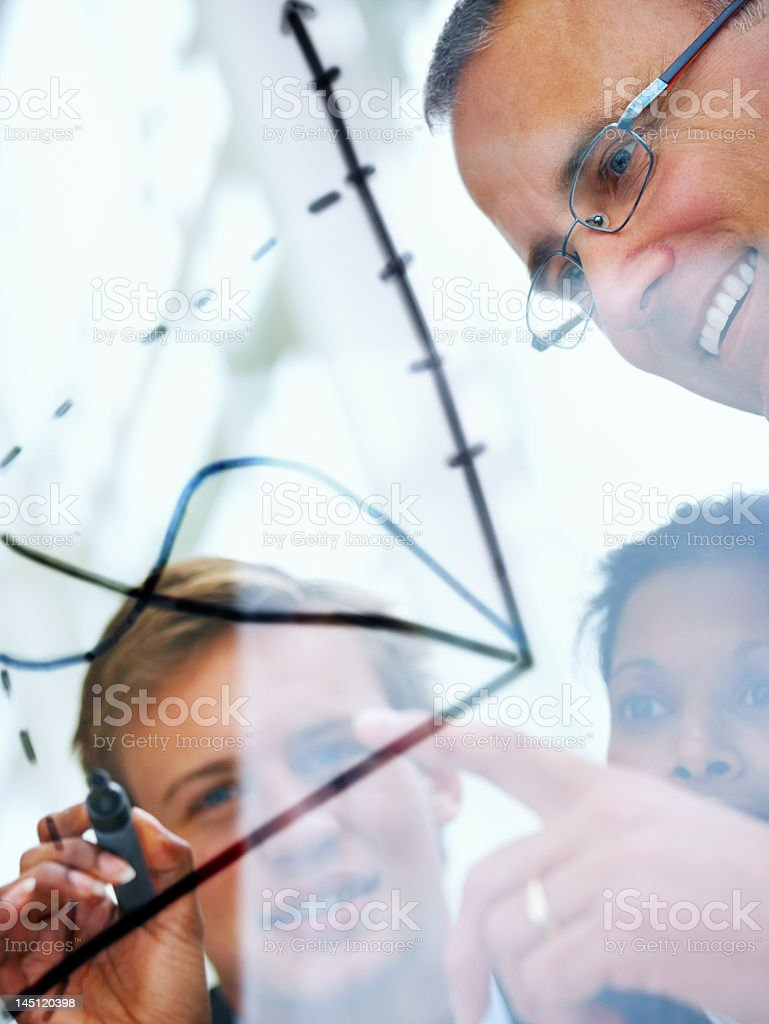 Close-up of senior businessman discussing future plans with his colleagues stock photo