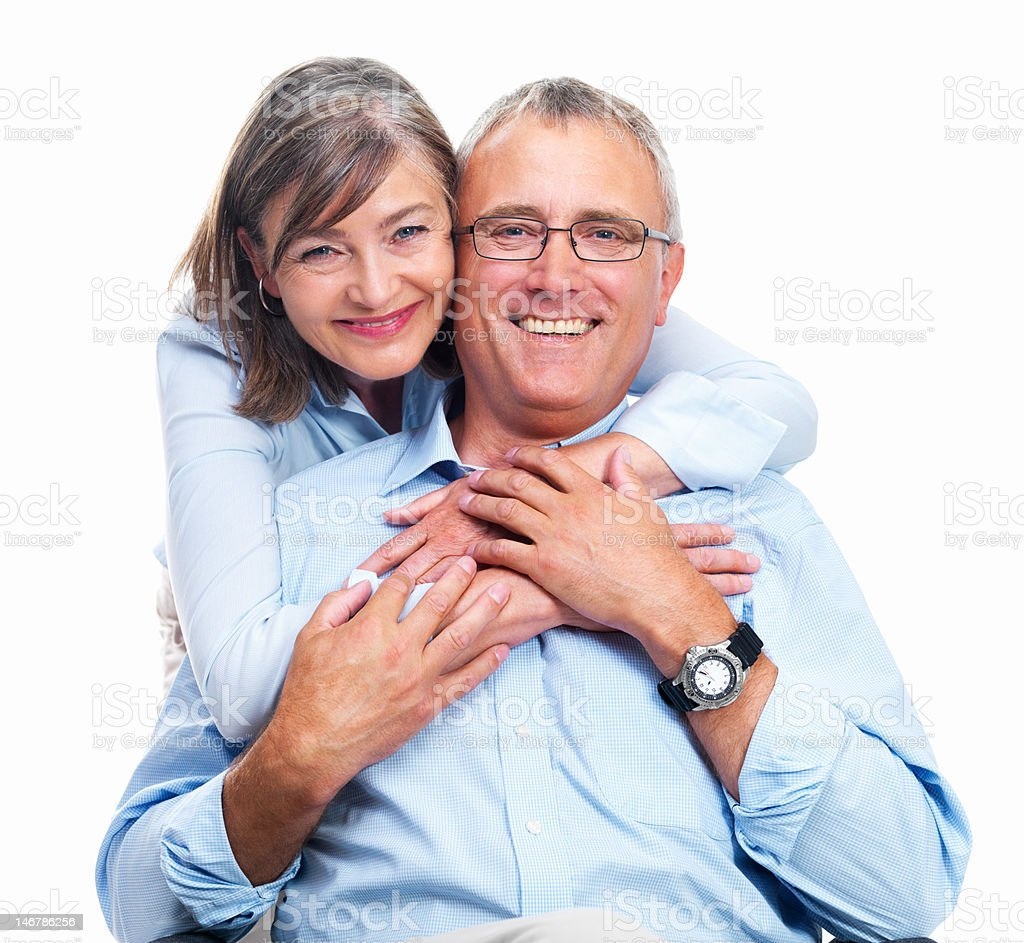 Close-up of senior couple embracing each other against white background royalty-free stock photo