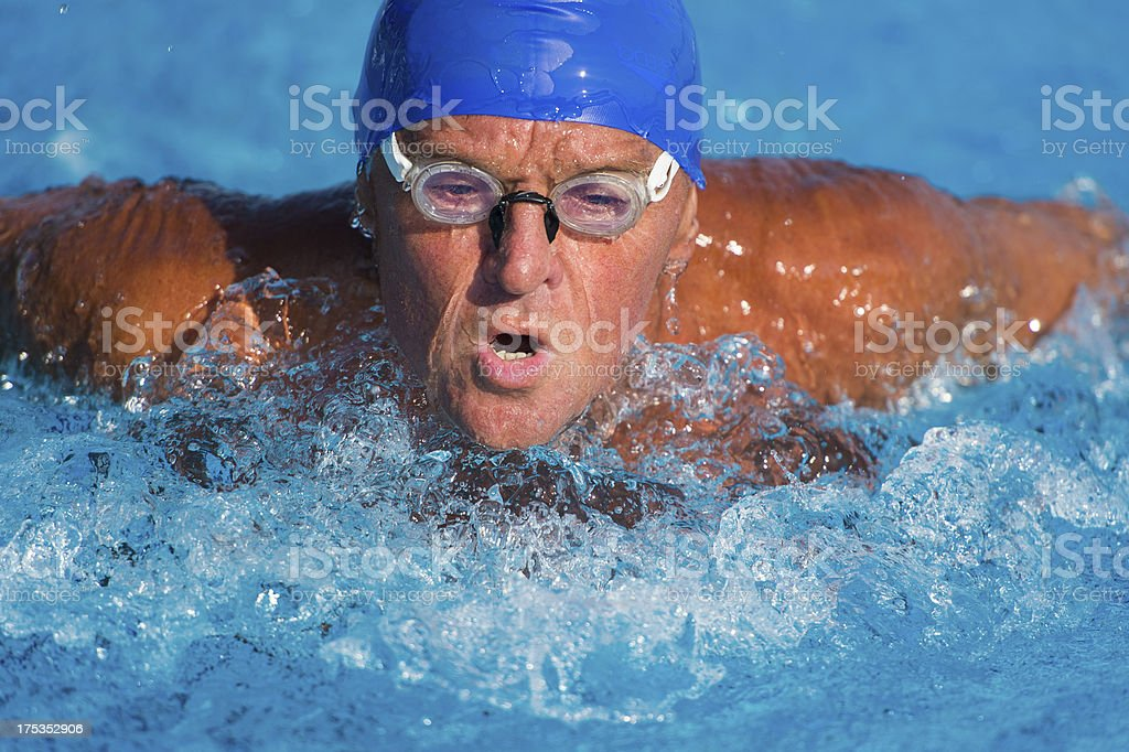 Close-up of senior man at butterfly stroke royalty-free stock photo