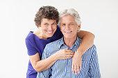 Closeup of Senior Woman Embracing Smiling Husband