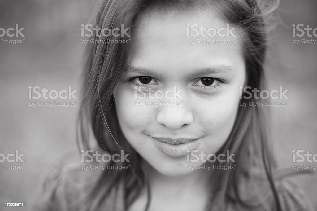 Closeup of Serious Girl With Dimples royalty-free stock photo