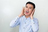 Closeup of Serious Young Asian Man Shouting Loud