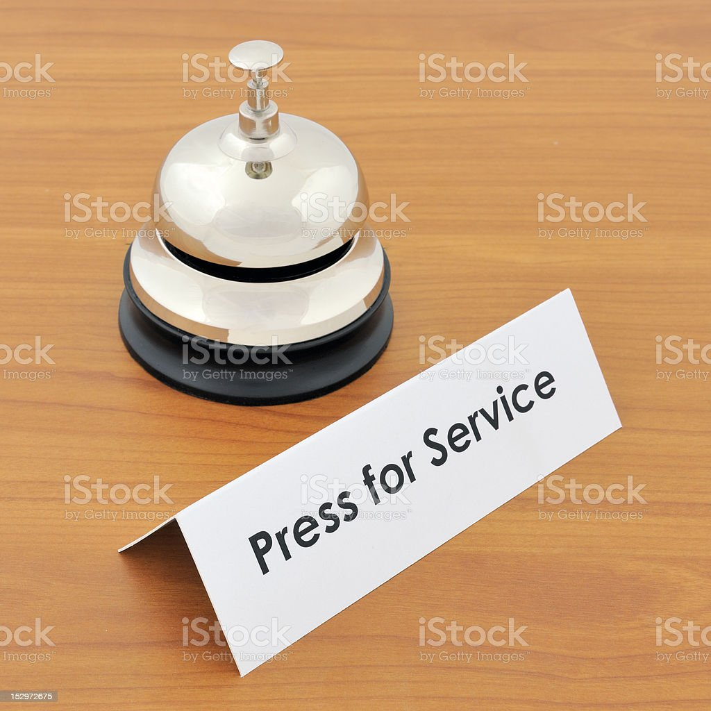 Closeup of service bell and sign royalty-free stock photo